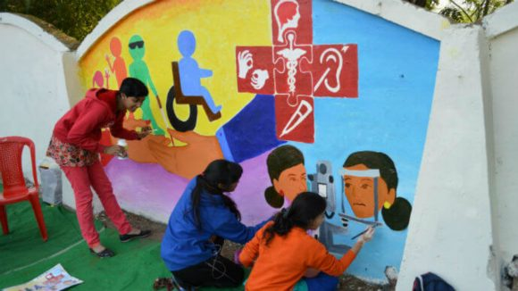 A mural being painted by art students in Bhopal, India.