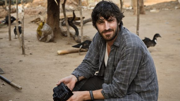 Eoin Macken, sitting and smiling.