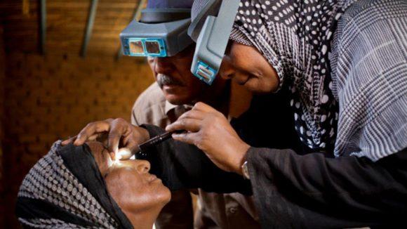 A Sudanese woman undergoes an eye examination.
