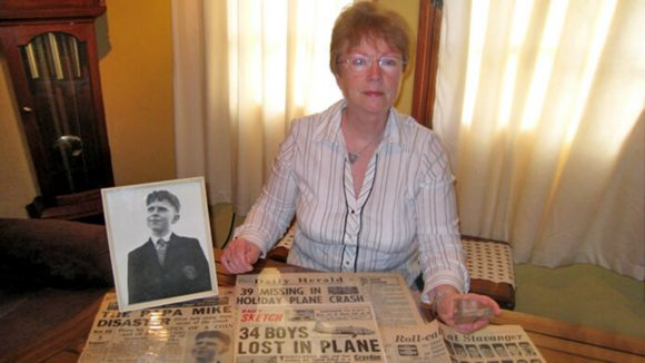 Rosalind Jones sits with a photograph of her brother.