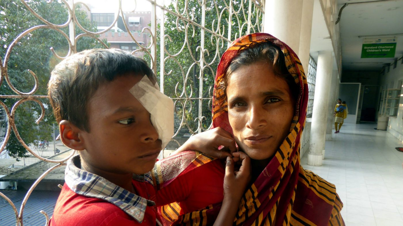 After the operation, Majidul's mother hugs him.