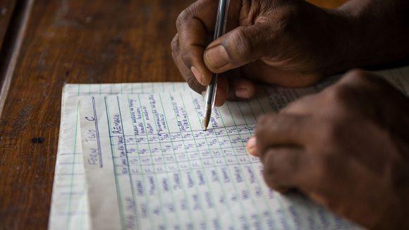 An eye health worker fills in some paperwork.