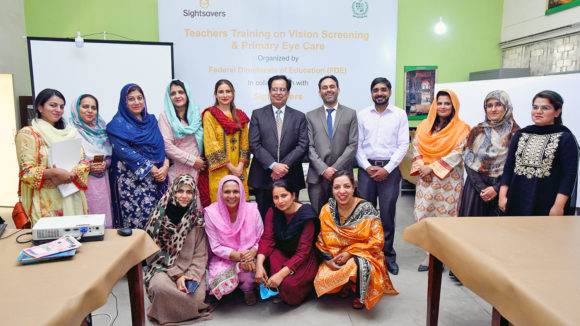 Teachers in Pakistan attend training to learn how to check their students' eyes.