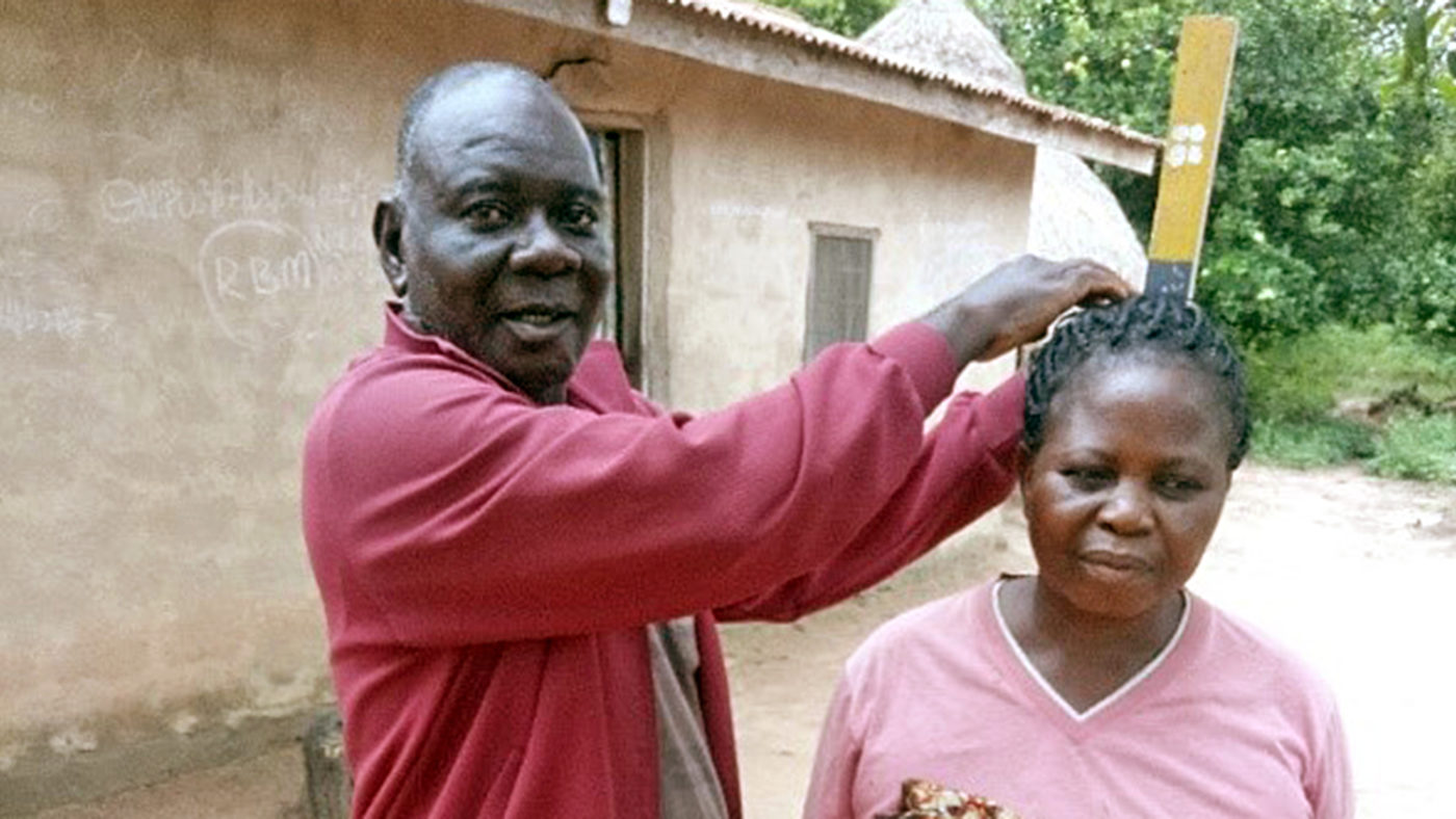 Emmanuel with a patient during his community work.