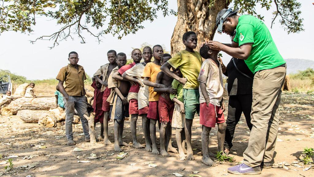 Givemore Mafukidze screening children in Mariga, Mbire, Zimbabwe